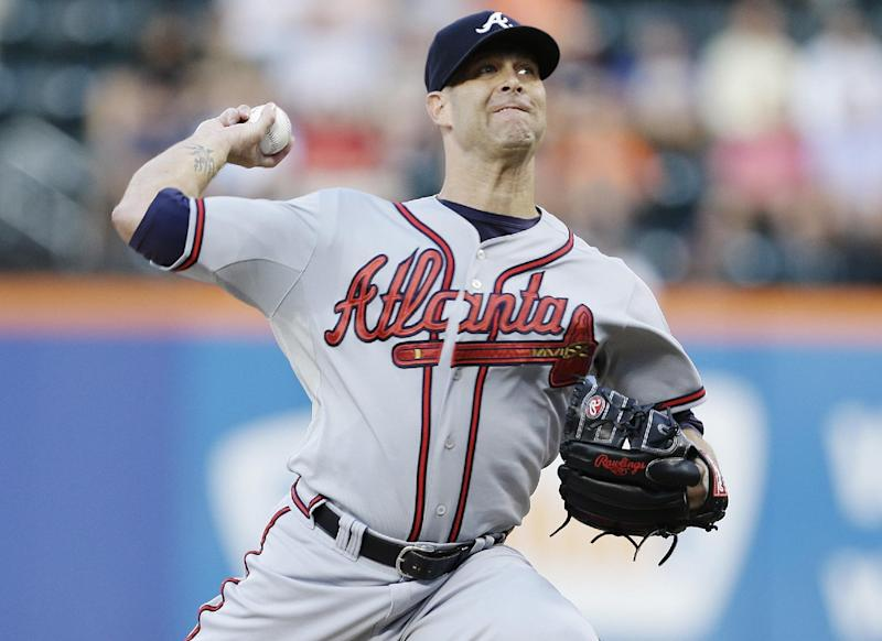 Atlanta Braves' Tim Hudson delivers a pitch during the first inning of a baseball game against the New York Mets, Wednesday, July 24, 2013, in New York. (AP Photo/Frank Franklin II)