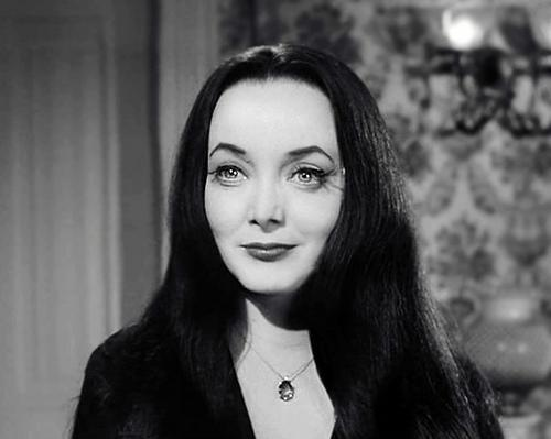 """<div class=""""caption-credit""""> Photo by: ABC</div><b>Morticia Addams on """"The Addams Family""""</b> <br> The original goth certainly had her own unique sense of style. Morticia's striking long black dress and matching raven hair is enhanced by her alabaster skin. Despite her penchant for snipping off the heads of roses, the matriarch of the Addams family is charming and quite beautiful."""