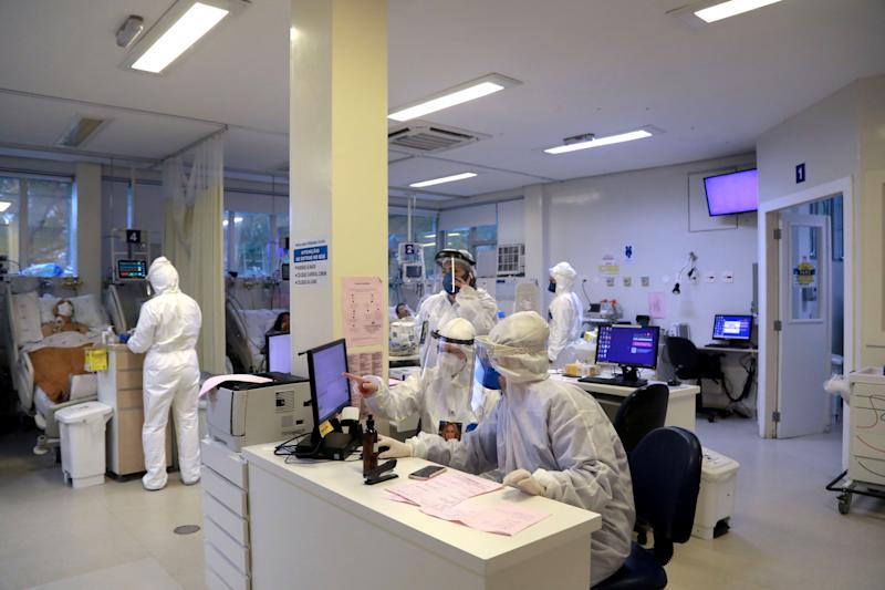General view of health workers and patients infected with COVID-19 at the Intensive Care Unit of the Santa Casa de Misericordia Hospital in Porto Alegre, Brazil, on August 13, 2020. - The occupancy of ICU beds by COVID-19 patients has risen and reached the highest mark since the beginning of the pandemic in Porto Alegre, where only a 9.4% of UCI beds remain empty. (Photo by SILVIO AVILA / AFP) (Photo by SILVIO AVILA/AFP via Getty Images)