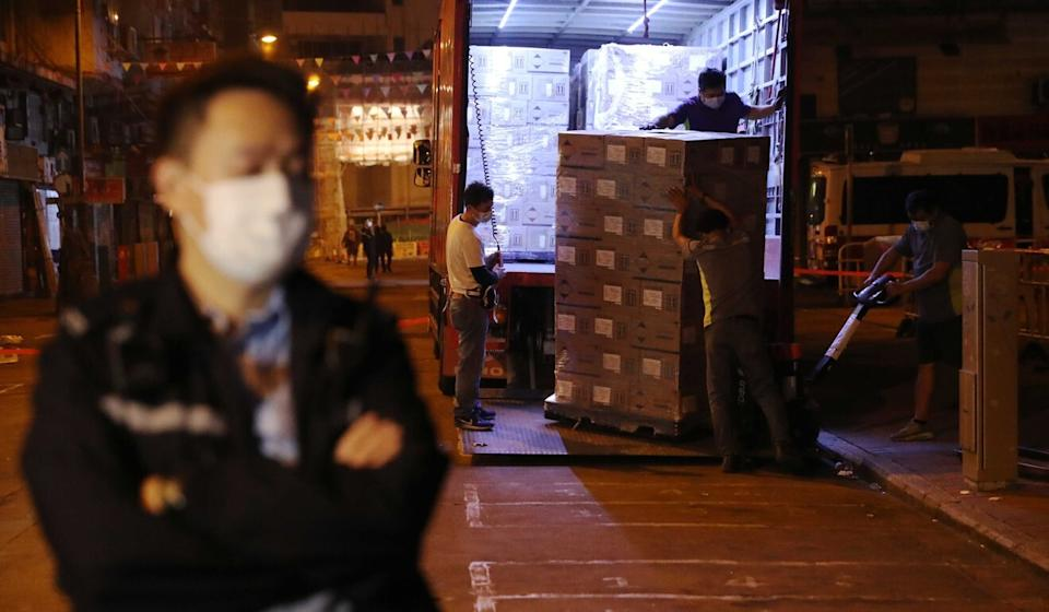 Supplies are unloaded at Woosung Street Temporary Cooked Food Hawker Bazaar. Photo: Edmund So