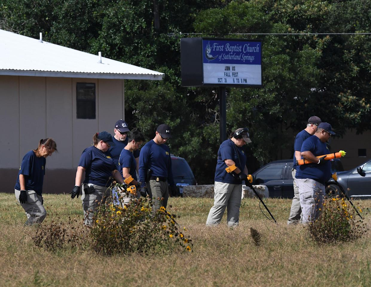 FBI agents search for clues on Monday at the entrance to the First Baptist Church, after the mass shooting in Sutherland Springs. (Photo: Mark Ralston/AFP/Getty Images)