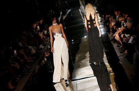 Models present creations from the Tom Ford Spring/Summer 2015 collection during London Fashion Week September 15, 2014. REUTERS/Suzanne Plunkett