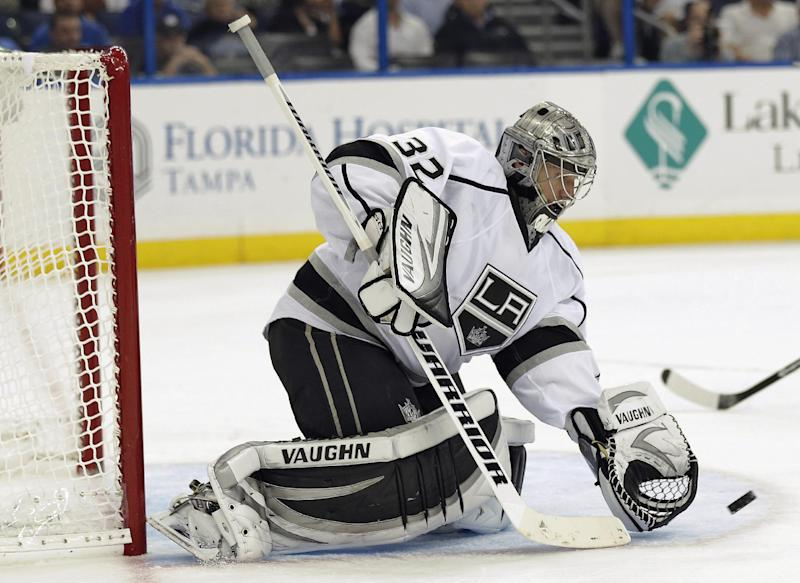 Los Angeles Kings goalie Jonathan Quick makes a glove save on a shot by the Tampa Bay Lightning during the second period of an NHL hockey game Tuesday, Oct. 15, 2013, in Tampa, Fla. (AP Photo/Chris O'Meara)