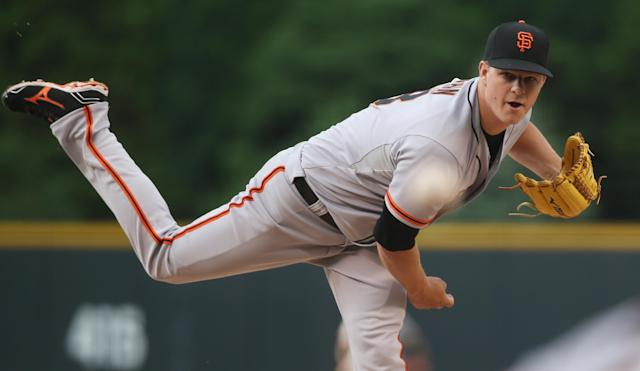San Francisco Giants starting pitcher Matt Cain works against the Colorado Rockies in the first inning of a baseball game in Denver on Wednesday, May 21, 2014. (AP Photo/David Zalubowski)