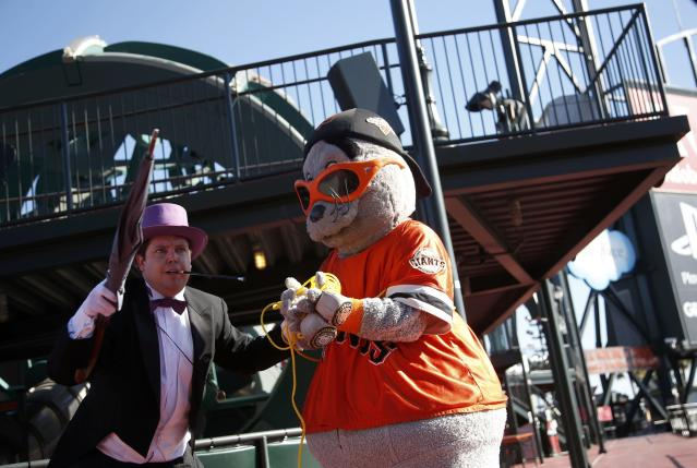 """The Penguin holds the San Francisco Giants mascot Lou Seal captive as they wait for the arrival of five-year-old leukemia survivor Miles, aka """"Batkid"""" as part of a day arranged by the Make- A - Wish Foundation in San Francisco, California November 15, 2013. The young cancer survivor will be treated to various super hero scenarios including receiving a commendation at San Francisco City Hall. REUTERS/Stephen Lam (UNITED STATES - Tags: SOCIETY ENTERTAINMENT)"""