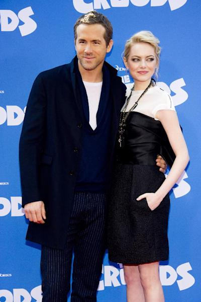"""FILE - This March 10, 2013 file photo shows actors Ryan Reynolds, left, and Emma Stone at """"The Croods"""" premiere in New York. Reynolds voices the character Guy and Stone voices the character Eep in the Dreamworks Animation film. (Photo by Charles Sykes/Invision/AP)"""