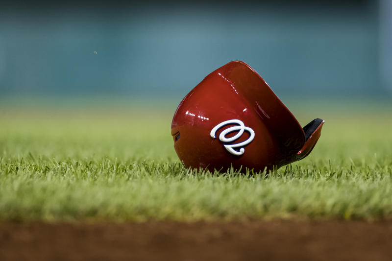 WASHINGTON, DC - AUGUST 17: The helmet of Juan Soto #22 of the Washington Nationals (not pictured) on the grass during the twelfth inning of a game against the Milwaukee Brewers at Nationals Park on August 17, 2019 in Washington, DC. (Photo by Scott Taetsch/Getty Images)