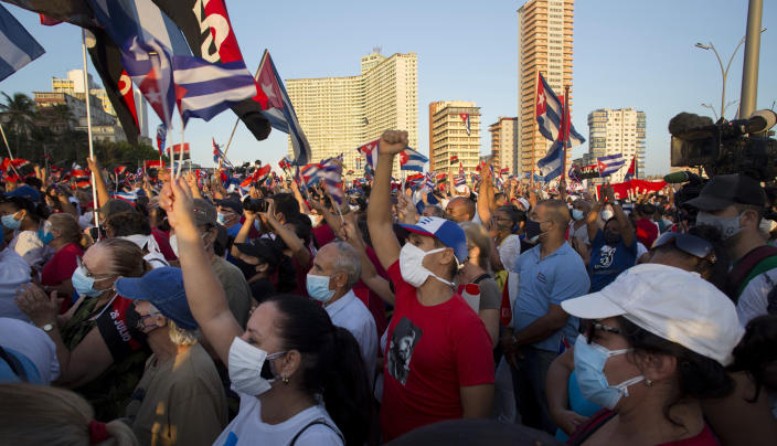 People attend a cultural-political event on the seaside Malecon Avenue with thousands of people in a show of support for the Cuban revolution six days after the uprising of anti-government protesters across the island, in Havana, Cuba, Saturday, July 17, 2021. (AP Photo / Ismael Francisco)