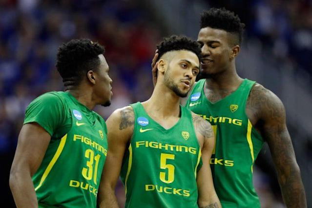 Tyler Dorsey (middle) and Jordan Bell (right) were the protagonists in Oregon's upset of Kansas. (Getty)
