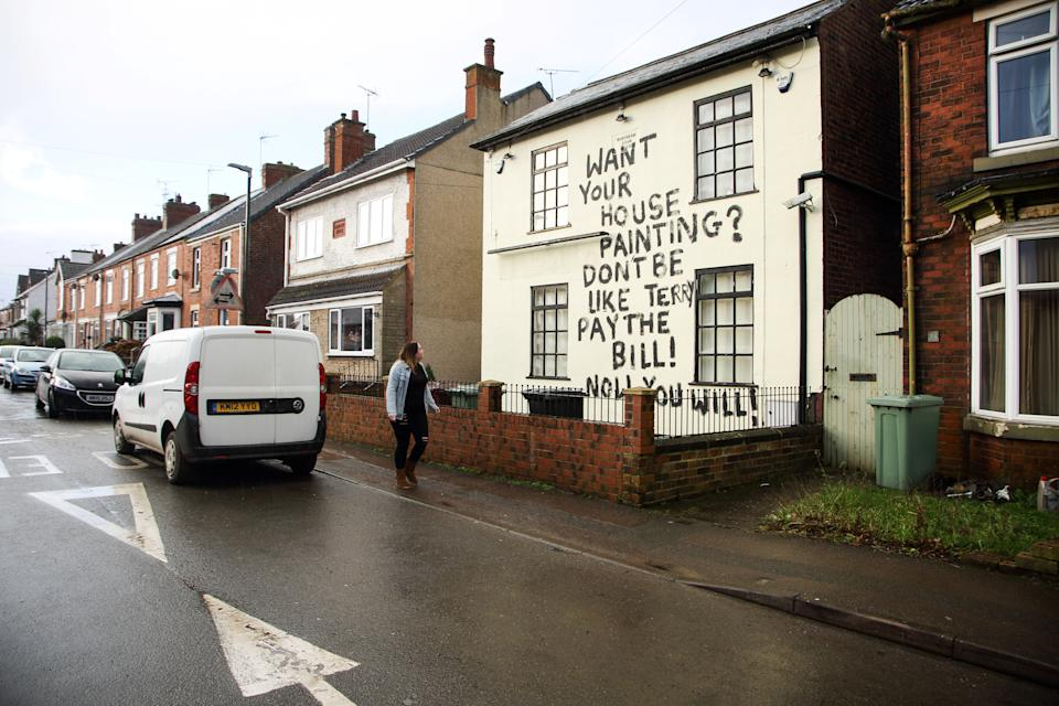 """The grafffiti reading  """"Want your house painting? Don't be like Terry, pay the bill! Now you will!"""" on a house on Welbeck Road,in Bolsover,  thought to have been painted in revenge by a person employed to paint the house who had not been paid for their work. January 17 2019. See SWNS story SWLEgraffiti."""