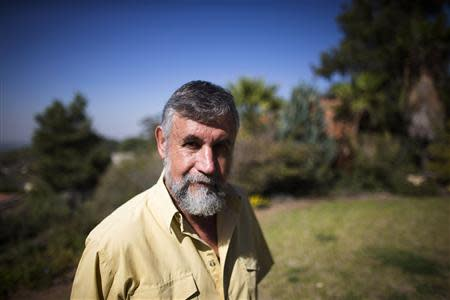Retired Israeli spy Mishka Ben-David poses for a picture outside his home in Ramat Raziel