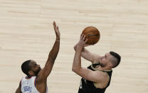 Atlanta Hawks' Danilo Gallinari (8) shoots and is fouled by New York Knicks' Alec Burks during the first half in Game 4 of an NBA basketball first-round playoff series Sunday, May 30, 2021, in Atlanta. (AP Photo/Brynn Anderson)