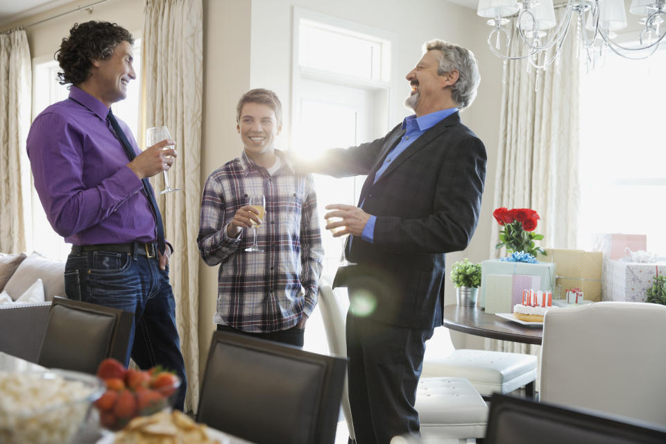 Men socializing at home during birthday party