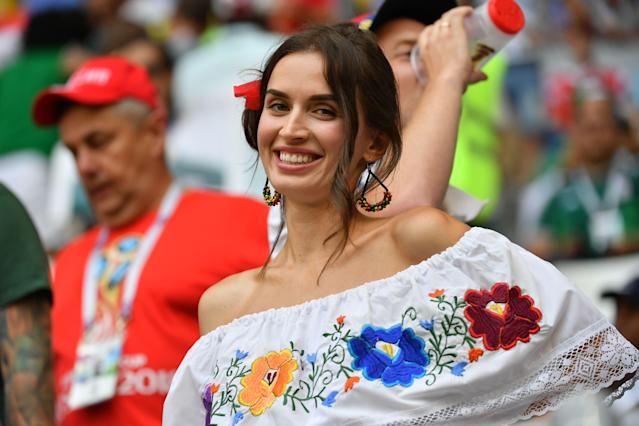 <p>A football fan poses before the Russia 2018 World Cup round of 16 football match between Brazil and Mexico at the Samara Arena in Samara on July 2, 2018. (Photo by EMMANUEL DUNAND / AFP) </p>