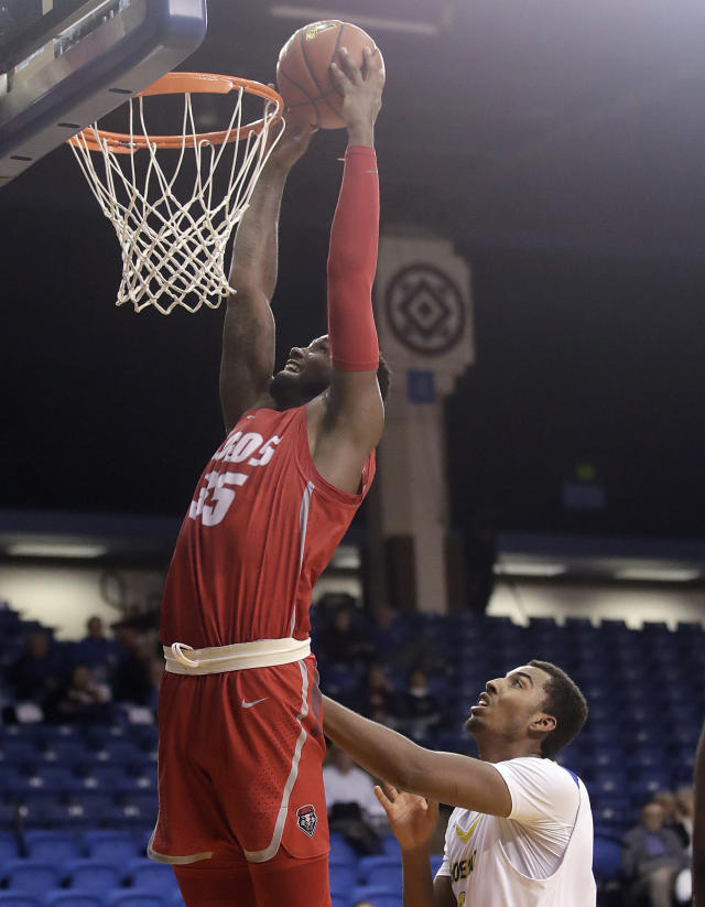 New Mexico forward Carlton Bragg (35) dunks over San Jose State forward Michael Steadman during the first half of an NCAA college basketball game in San Jose, Calif., Tuesday, Feb. 26, 2019. (AP Photo/Jeff Chiu)
