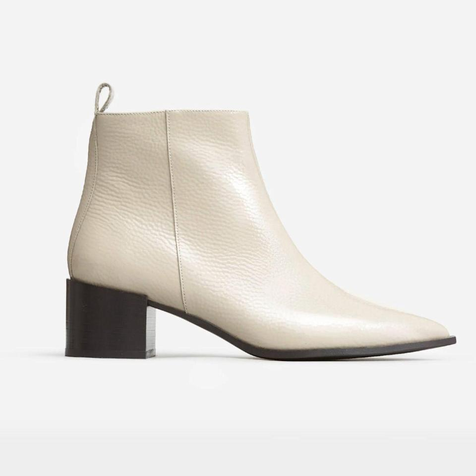 """<p><strong>Everlane</strong></p><p>everlane.com</p><p><strong>$198.00</strong></p><p><a href=""""https://go.redirectingat.com?id=74968X1596630&url=https%3A%2F%2Fwww.everlane.com%2Fproducts%2Fwomens-boss-boot-bonepatent&sref=https%3A%2F%2Fwww.goodhousekeeping.com%2Fclothing%2Fg33264582%2Fmost-comfortable-shoes%2F"""" rel=""""nofollow noopener"""" target=""""_blank"""" data-ylk=""""slk:Shop Now"""" class=""""link rapid-noclick-resp"""">Shop Now</a></p><p>With <strong>a pointed toe and a two inch block heel</strong>, these boots live up to their name: The Boss Boot. Perfect to wear to the office or dance floor, these Italian leather boots are designed to be comfy no matter where you wear them. Available in five colors, over 1,000 reviewers say that these are super comfortable boots you need in your closet. </p>"""