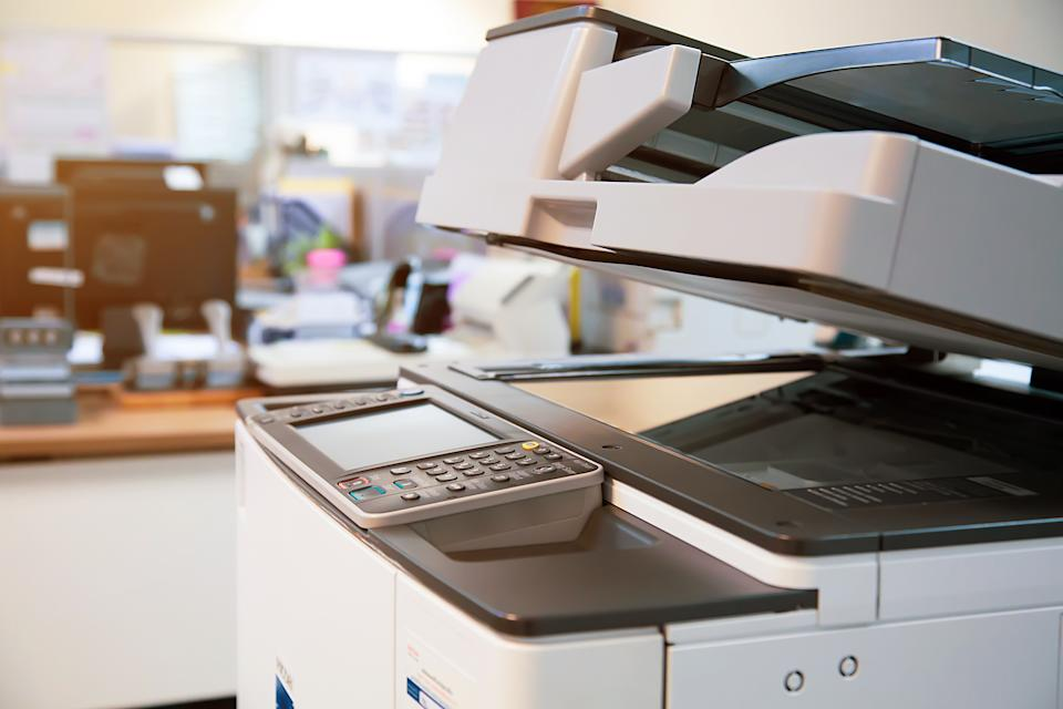 Close-up photocopier or printer is office worker tool equipment for scanning and copy paper.