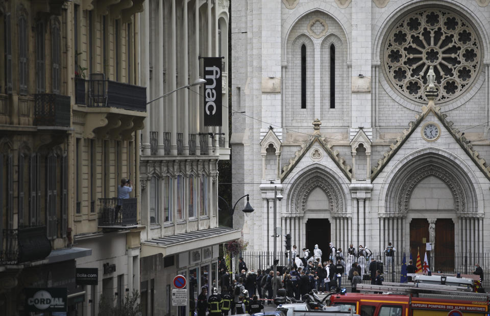 Police officers work at the Notre Dame church in Nice, southern France, after a knife attack took place on October 29, 2020.
