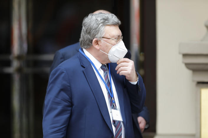 Russia's Governor to the International Atomic Energy Agency, IAEA, Mikhail Ulyanov, stand in front the 'Grand Hotel Wien' where closed-door nuclear talks with Iran take place in Vienna, Austria, Tuesday, April 20, 2021. (AP Photo/Lisa Leutner)