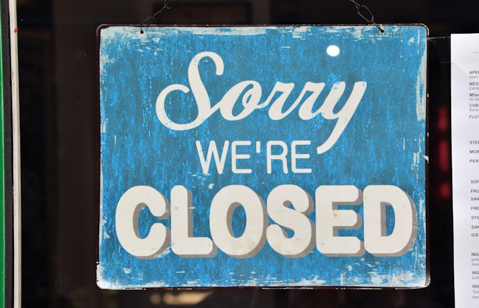 London, United Kingdom - November 15 2020: Detail of a Sorry We're Closed sign in a restaurant window in Central London during the second national lockdown in England.