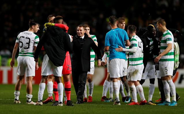 Soccer Football - Europa League Round of 32 First Leg - Celtic vs Zenit Saint Petersburg - Celtic Park, Glasgow, Britain - February 15, 2018 Celtic manager Brendan Rodgers celebrates with his players after the match Action Images via Reuters/Lee Smith