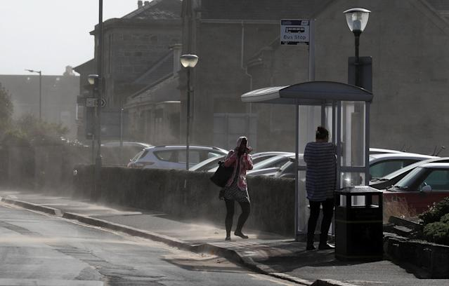 People struggling in the wind in Troon in Ayrshire. (PA)