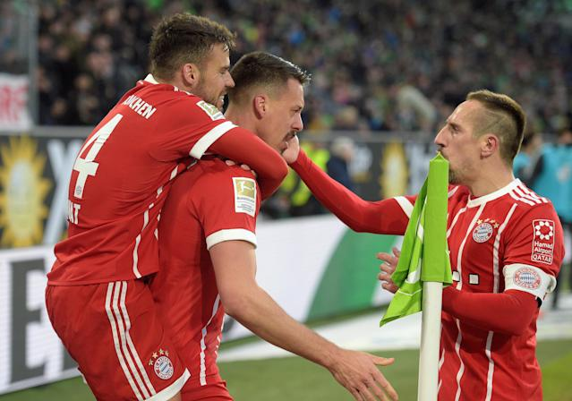 Soccer Football - Bundesliga - VfL Wolfsburg vs Bayern Munich - Volkswagen Arena, Wolfsburg, Germany - February 17, 2018 Bayern Munich's Sandro Wagner celebrates scoring their first goal with Juan Bernat and Franck Ribery REUTERS/Fabian Bimmer DFL RULES TO LIMIT THE ONLINE USAGE DURING MATCH TIME TO 15 PICTURES PER GAME. IMAGE SEQUENCES TO SIMULATE VIDEO IS NOT ALLOWED AT ANY TIME. FOR FURTHER QUERIES PLEASE CONTACT DFL DIRECTLY AT + 49 69 650050