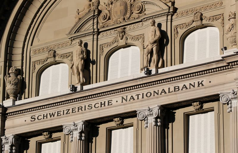 FILE PHOTO: Statues are seen on the building of the Swiss National Bank SNB in Bern