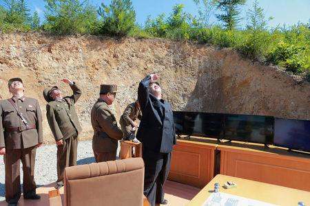 North Korean leader Kim Jong Un looks on during the test-launch of the intercontinental ballistic missile Hwasong-14 in this undated photo released by North Korea's KCNA in Pyongyang