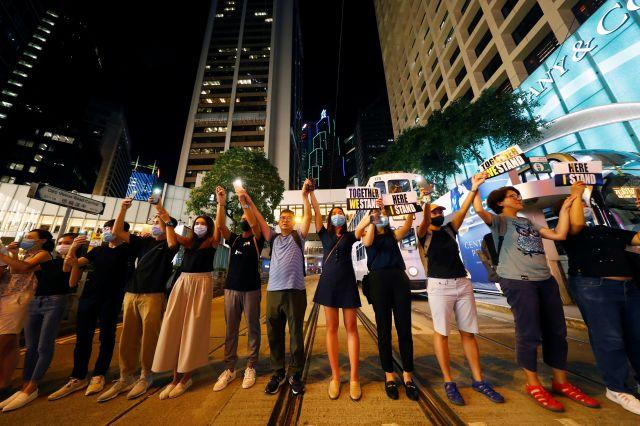 Protesters hold hands to form a human chain during a rally to call for political reforms in Hong Kong's Central district, China, August 23, 2019.