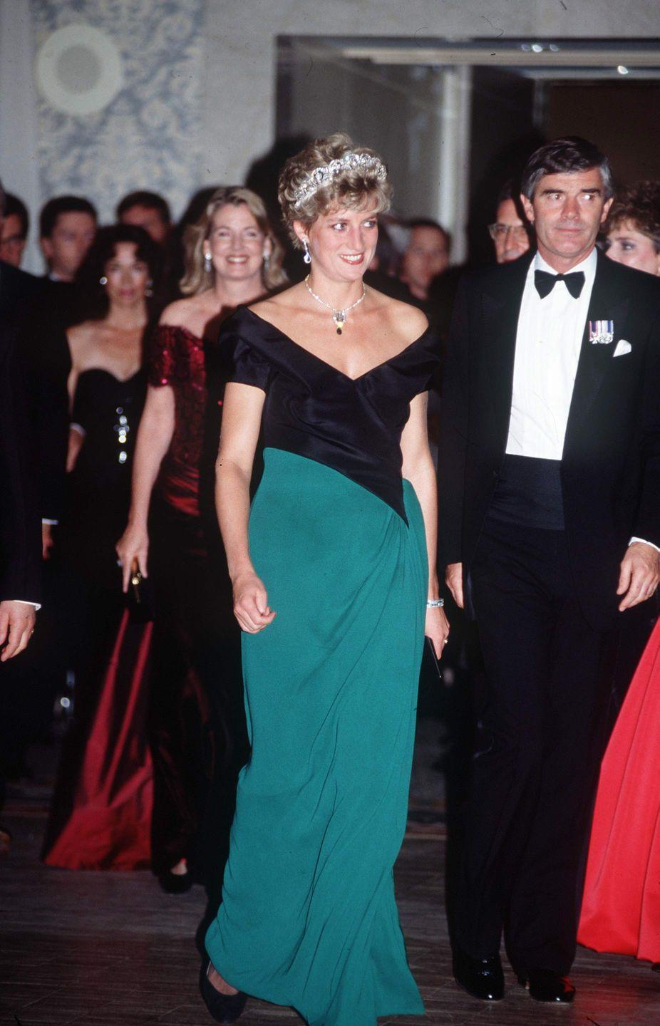 <p>At a gala in Toronto, Canada, Diana chose a silk and crepe evening gown by Catherine Walker. She also sported the Spencer tiara and a pendant necklace. </p>
