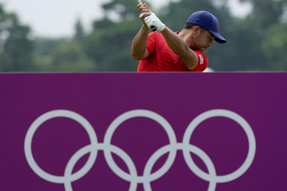Xander Shauffele of United States hits a tee shot on the 17th hole during the first round of the men's golf event at the 2020 Summer Olympics, Friday, July 30, 2021, at the Kasumigaseki Country Club in Kawagoe, Japan, (AP Photo/Matt York)
