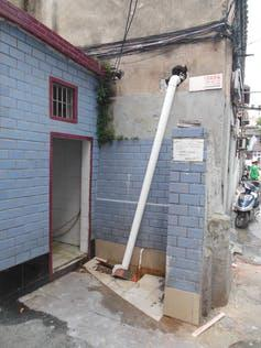 """<span class=""""caption"""">Self-installed flush toilets like this one in Shanghai often just empty into rainwater drains.</span> <span class=""""attribution""""><span class=""""source"""">Deljana Iossifova</span>, <span class=""""license"""">Author provided</span></span>"""