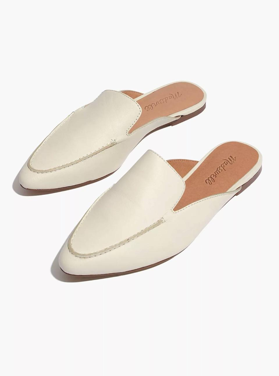 """These slip-on white loafers are the perfect finishing touch to any work-ready outfit. The stitch detailing and pointed toe will instantly zhuzh up whatever else you have on up top. $118, Madewell. <a href=""""https://www.madewell.com/the-frances-skimmer-mule-in-leather-AN113.html?"""" rel=""""nofollow noopener"""" target=""""_blank"""" data-ylk=""""slk:Get it now!"""" class=""""link rapid-noclick-resp"""">Get it now!</a>"""