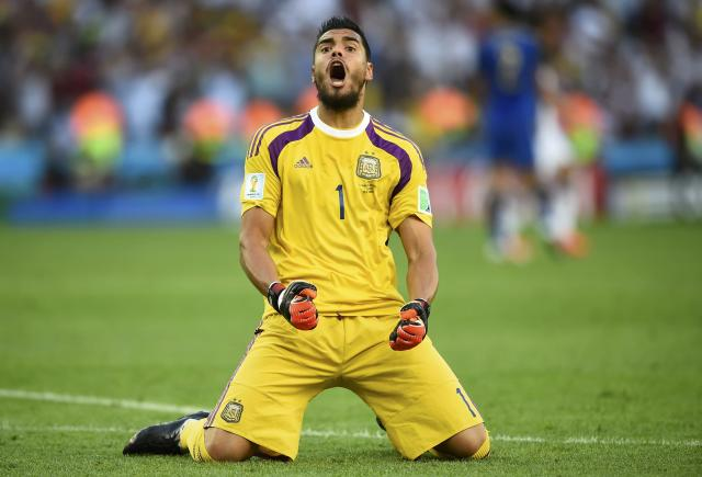 Argentina's goalkeeper Sergio Romero reacts to an offside goal by teammate Gonzalo Higuain (not pictured) during their 2014 World Cup final against Germany at the Maracana stadium in Rio de Janeiro July 13, 2014. REUTERS/Dylan Martinez (BRAZIL - Tags: SOCCER SPORT WORLD CUP)