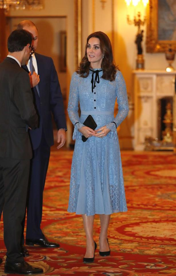 """<p>The Duchess made her first public appearance at a Buckingham Palace reception since announcing <a rel=""""nofollow"""" href=""""http://www.townandcountrymag.com/society/tradition/a12167619/kate-middleton-due-date-2018/"""">her third pregnancy</a>. Though Duchess Kate is still <a rel=""""nofollow"""" href=""""http://www.townandcountrymag.com/society/tradition/a12185279/kate-middleton-hyperemesis-gravidarum-morning-sickness-meaning/"""">suffering from Hyperemesis Gravidarum</a>, her light blue, Temperley dress set a cheery tone over her new <a rel=""""nofollow"""" href=""""http://www.townandcountrymag.com/society/tradition/a12810469/kate-middleton-baby-bump-photos/"""">baby bump</a>. The knee-length, lace ensemble had black detailing in its front buttons and bowtie neckline, to which Kate matched a black clutch, black pumps, and a pair of blue topaz and diamond earrings by Kiki McDonough.</p>"""