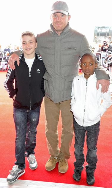 Harry Potter premiere: Guy Ritchie was in attendance with sons Rocco and David Banda, lets hope all three of them smiled once they got on set!