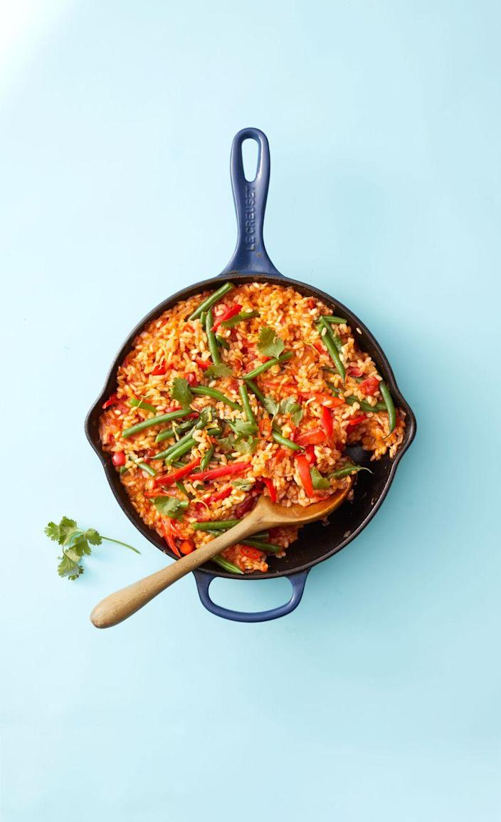 """<p>With peppers, red chile, tomato, and green beans, plus a ton of herbs and spices, there's no shortage of flavor in this one-skillet rice dish.</p><p><em><a href=""""https://www.goodhousekeeping.com/food-recipes/a35463713/vegetable-paella-recipe/"""" rel=""""nofollow noopener"""" target=""""_blank"""" data-ylk=""""slk:Get the recipe for Vegetable Paella »"""" class=""""link rapid-noclick-resp"""">Get the recipe for Vegetable Paella »</a></em></p>"""