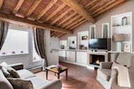 """At under $200 a night, this one-bedroom Airbnb Plus is a steal, especially considering the stellar rooftop views over <a href=""""https://www.cntraveler.com/destinations/florence?mbid=synd_yahoo_rss"""" rel=""""nofollow noopener"""" target=""""_blank"""" data-ylk=""""slk:Florence"""" class=""""link rapid-noclick-resp"""">Florence</a>, including a look at the <a href=""""https://www.cntraveler.com/activities/florence/santa-maria-del-fiore-the-duomo?mbid=synd_yahoo_rss"""" rel=""""nofollow noopener"""" target=""""_blank"""" data-ylk=""""slk:Duomo"""" class=""""link rapid-noclick-resp"""">Duomo</a>. Though it's on the top floor, this apartment has an elevator, so over-packers can breathe a sigh of relief—plus its location in the building means it has incredible, original wood-beam ceilings. Located on the north side of the Arno, this rental is just a few blocks from the central train station for easy access in and out of the city, and about a 10-minute walk from the Uffizi. $141, Airbnb (Starting Price). <a href=""""https://www.airbnb.com/rooms/plus/2165192"""" rel=""""nofollow noopener"""" target=""""_blank"""" data-ylk=""""slk:Get it now!"""" class=""""link rapid-noclick-resp"""">Get it now!</a>"""