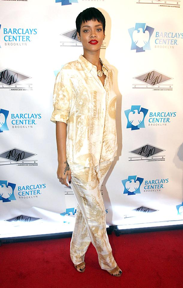 "Speaking of poorly-dressed pop stars, take a look at what Rihanna failed to rock at the opening of the 40/40 Club in Brooklyn. Coffee-stained pajamas in public? Really? (9/27/2012)<br><br><a target=""_blank"" href=""http://omg.yahoo.com/news/chris-brown-rihanna-back-together-190500270.html"">Are Rihanna and Chris Brown back together?</a>"