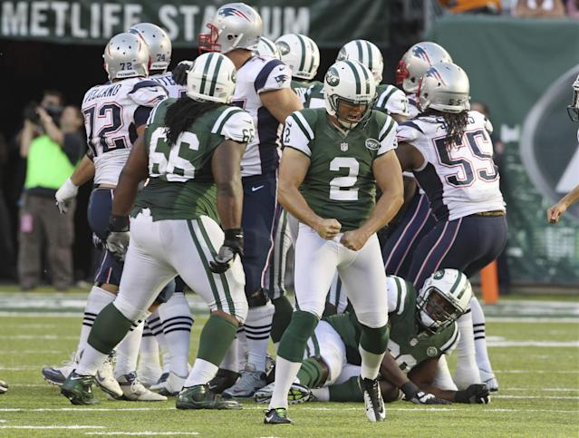 New York Jets kicker Nick Folk (2) reacts after kicking the game-winning field goal during overtime of an NFL football game Sunday, Oct. 20, 2013, in East Rutherford, N.J. The Jets won the game 30-27. (AP Photo/Peter Morgan)