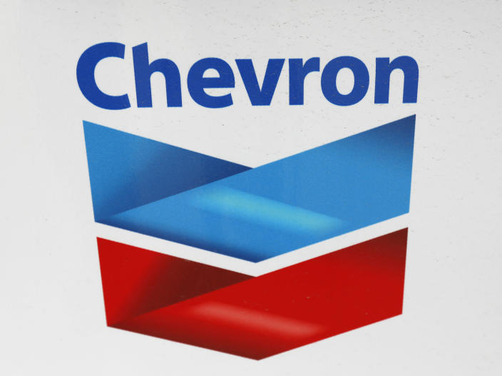 FILE - In this Wednesday, June 26, 2019, file photo, a Chevron corporate logo is displayed on a gas pump in Flowood, Miss. Warren Buffett's company made major new investments in Verizon and Chevron and again trimmed its huge stake in Apple while making several other adjustments to its stock portfolio last year. Berkshire Hathaway said in a regulatory filing Tuesday, Feb. 16, 2021, that it bought $8.6 billion worth of Verizon stock and picked up $4 billion worth of Chevron shares over the last six months of 2020. (AP Photo/Rogelio V. Solis, File)
