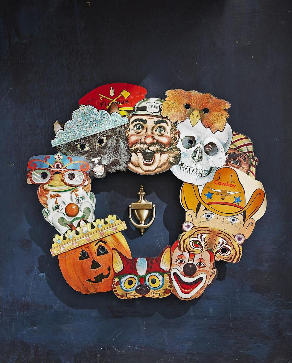 <p>It will only take a few minutes to craft this friendly Halloween focused wreath.<br><br>Source colorful vintage paper masks from websites like Etsy and eBay—you will need 10 to 15 total. Attach to an 18-inch craft<br>ring with a dab of hot-glue, layering and overlapping them as you go.<br></p>