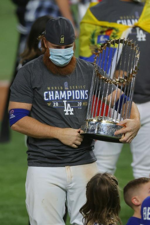 Justin Turner on the field with the World Series trophy after the Los Angeles Dodgers victory over the Tampa Bay Rays