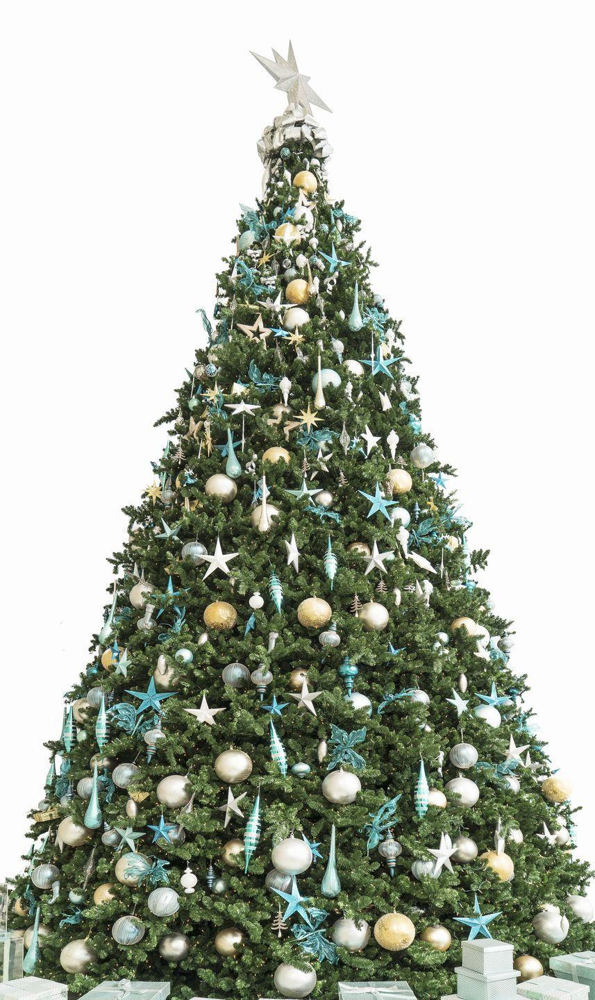<p>For a coastal-inspired Christmas tree, pair pastels and cooler shades such as aqua and blue. </p>