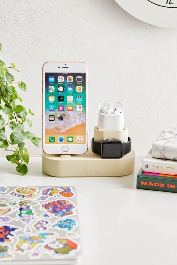 """<p>They can charge their phone, watch, and AirPods all at once with this helpful <a href=""""https://www.popsugar.com/buy/Elago-Charging-Hub-376801?p_name=Elago%20Charging%20Hub&retailer=urbanoutfitters.com&pid=376801&price=25&evar1=savvy%3Aus&evar9=45684857&evar98=https%3A%2F%2Fwww.popsugar.com%2Ffood%2Fphoto-gallery%2F45684857%2Fimage%2F46825593%2FElago-Charging-Hub&list1=shopping%2Cgifts%2Cgift%20guide%2Cgifts%20for%20men%2Cbest%20of%202019&prop13=api&pdata=1"""" class=""""link rapid-noclick-resp"""" rel=""""nofollow noopener"""" target=""""_blank"""" data-ylk=""""slk:Elago Charging Hub"""">Elago Charging Hub</a> ($25).</p>"""