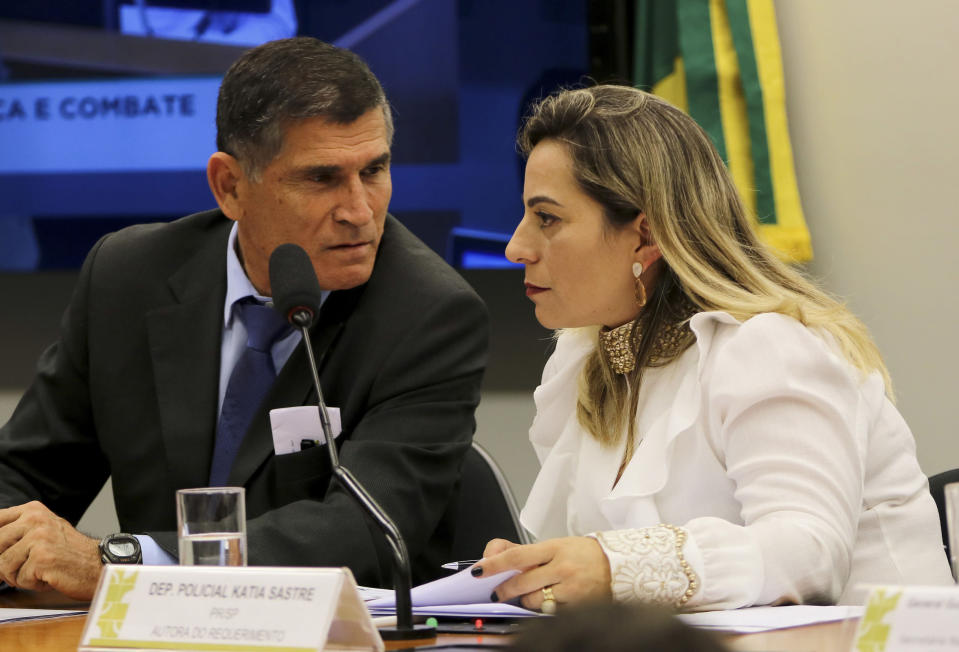 FILE - In this April 24, 2019 handout photo, Congresswoman Katia Sastre, an ally of President Jair Bolsonaro, talks with then Secretary of Government Minister Alberto dos Santos Cruz, at Congress in Brasilia, Brazil. Sastre is backing President Jair Bolsonaro's push to deliver a gun to every Brazilian who wants one, and dismisses public security experts' concerns about the president's four recently issued gun decrees. (Wilson Dias/Agencia Brasil via AP File)