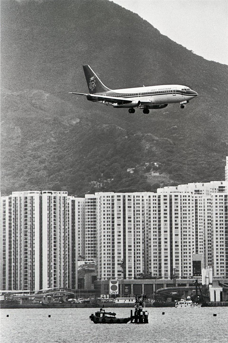 A Dragonair plane flies over Taikoo Shing in Hong Kong in 1988. Photo: SCMP