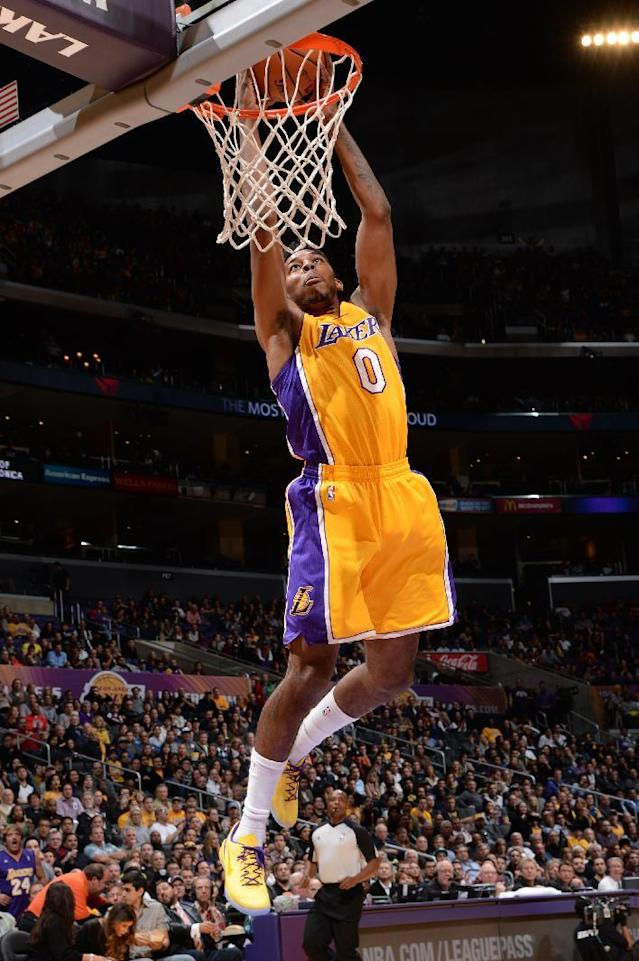 LOS ANGELES, CA - NOVEMBER 22: Nick Young #0 of the Los Angeles Lakers attempts a dunk during a game against the Golden State Warriors on November 22, 2013 at STAPLES Center in Los Angeles, California. (Photo by Andrew D. Bernstein/NBAE via Getty Images)
