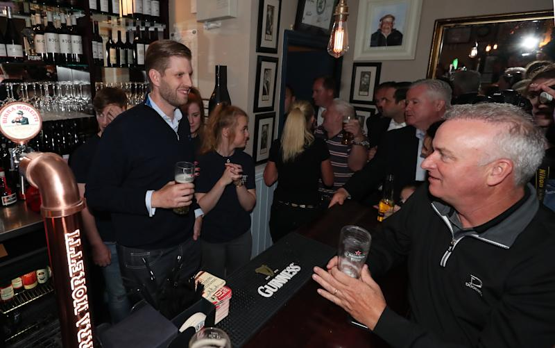 Eric Trump, the son of US President Donald Trump, pours pints and meets locals in the village of Doonbeg in County Clare, on the first day of US President Donald Trump's visit to the Republic of Ireland. (Photo by Niall Carson/PA Images via Getty Images)